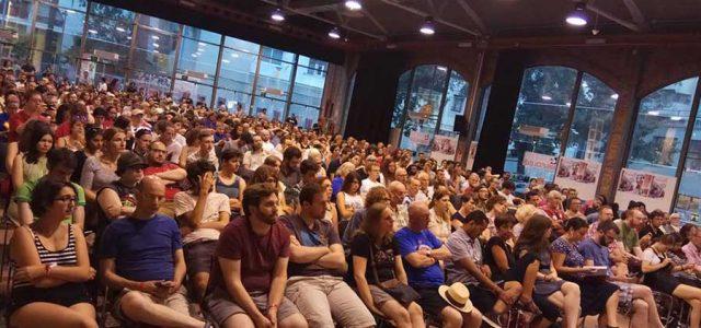 Estado Español / Catalunya – ¡Más de 600 personas llenan las Cocheras de Sans en el Mitin de defensa de la Revolución de Octubre!